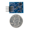 Size comparison product image of the Pmod TMP2: Temperature Sensor and a US quarter (diameter of quarter: 0.955 inches [24.26 mm]; width: 0.069 inches [1.75 mm]).