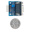Size comparison product image of the Pmod RS232: Serial Converter and Interface Standard and a US quarter (diameter of quarter: 0.955 inches [24.26 mm]; width: 0.069 inches [1.75 mm]).