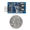 Size comparison product image of the Pmod RTCC: Real-time Clock / Calendar and a US quarter (diameter of quarter: 0.955 inches [24.26 mm]; width: 0.069 inches [1.75 mm]).