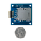 Size comparison product image of the Pmod SD: Full-sized SD Card Slot and a US quarter (diameter of quarter: 0.955 inches [24.26 mm]; width: 0.069 inches [1.75 mm]).