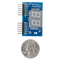 Size comparison product image of the Pmod SSD: Seven-segment Display and a US quarter (diameter of quarter: 0.955 inches [24.26 mm]; width: 0.069 inches [1.75 mm]).