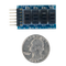 Size comparison product image of the Pmod SWT: 4 User Slide Switches and a US quarter (diameter of quarter: 0.955 inches [24.26 mm]; width: 0.069 inches [1.75 mm]).