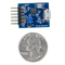 Size comparison product image of the Pmod USBUART: USB to UART Interface and a US quarter (diameter of quarter: 0.955 inches [24.26 mm]; width: 0.069 inches [1.75 mm]).