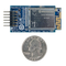 Size comparison product image of the Pmod WiFi and a US quarter (diameter of quarter: 0.955 inches [24.26 mm]; width: 0.069 inches [1.75 mm]).