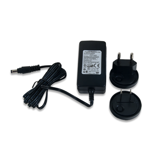 5V 2.5A Switching Power Supply product image with the included European/UK Wall Plug Adapters.