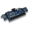 Product image of the Basys 3 Pmod Pack displaying the ease of plugging the included Pmods into the Basys 3 FPGA. Includes the Pmod KYPD, Pmod AMP2, Pmod ALS, Pmod R2R, Pmod OLED. Basys 3 sold separately.