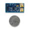 Size comparison product image of the Pmod IA: Impedance Analyzer and a US quarter (diameter of quarter: 0.955 inches [24.26 mm]; width: 0.069 inches [1.75 mm]).