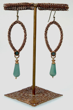 Twisted wire rods formed into inverted teardrop shapes with  beautiful Green Aventine drops and stones to set off the Antique Brass metal. These earrings are sealed and finished with completely hypoallergenic titanium wires.