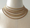 Gold Cleopatra graduated stretchy flat cobra chain necklace. This necklace is adjustable and can sit tight at the neck or be loosened to be more like a collar.