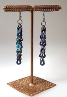 Teardrop Chain drop earrings oxodized black with Ultra Violet and Arcadia Green. These earrings have anodized titanium ear wires to coordinate with the unique coloring of this distinctive chain. The base metal is brass.