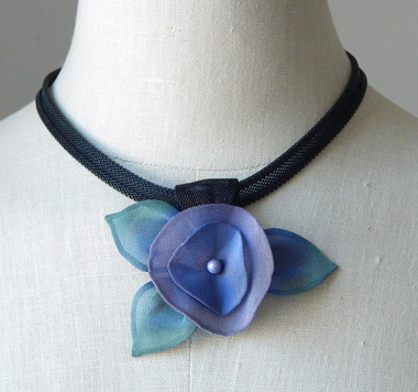 Oxidized black necklace with a pansy slide pendant.  this necklace is shown in black with blue and green pearlescent finish.