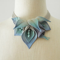 Silver with lavender and blue lilies and lavender and aqua leaves