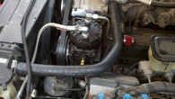 This photo shows the new upper radiator hose routing.