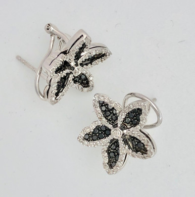 Black and white diamond earrings. Flower design with omega clip and .65 ct black diamonds and .45 ct white diamonds
