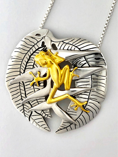 Sterling with gold plate Rainforest frog pendant. Pendant is a reproduction of a shell cameo carved by the Embera-Wounaan, a semi-nomadic indigenous people born in the Darien jungle of Panama.  Approximately 1 3/4 inches in diameter.