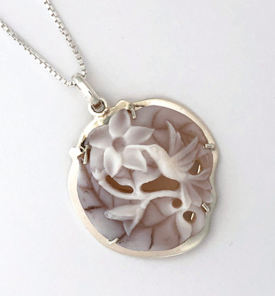 Unique, Nature inspired handcrafted shell cameo. Carved by the indigenous Wounaad people of the Darien rainforest of Panama.