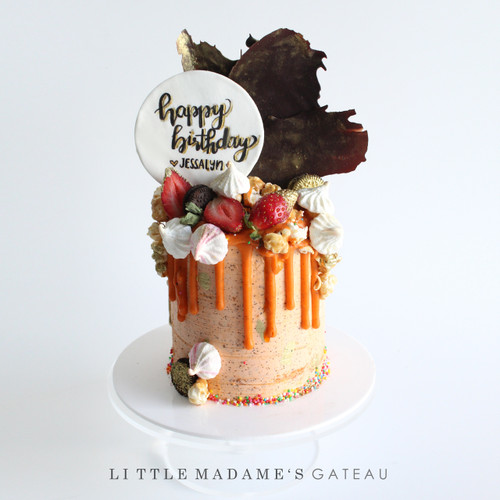 Thai milk tea drip cake with chocolate sail
