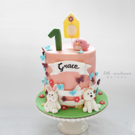 double barrel pink girly kids birthday cake