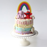 jelly cat and elmo rainbow buttercream cake