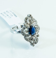 18 KT White Gold with Oval Cut Sapphire and .44 Carats of Micro Pave Diamonds