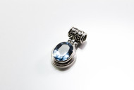 Oval-Shaped Faceted Blue Topaz Pendant