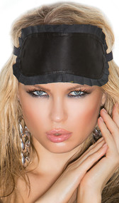 Leather blindfold with ruffle trim and adjustable elastic strap with clasp. Inside is leather lined.