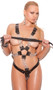 Leather and chain harness with O ring details and adjustable buckle closures on shoulder straps and sides. Unisex.
