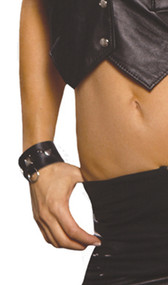 Leather wrist cuffs with square nail heads, heart nail heads and o ring. Adjustable snap closure.
