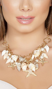 Shell necklace with beaded starfish and faux pearl accents with adjustable lobster clasp closure.