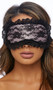 Satin and lace blindfold with ribbon tie back and slight padding. Inside is lined with plain satin.