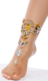 Rhinestone foot jewelry with toe loop, elastic straps, and adjustable lobster clasp closure on chain.