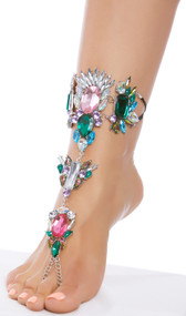 Rhinestone foot jewelry with toe loop, elastic straps, and adjustable lobster clasp closure on chain. One per package.