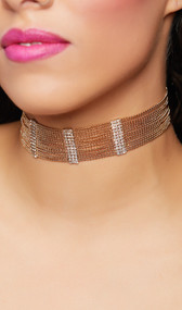 Collar choker with columns of rhinestones between rows of draped chain and adjustable lobster clasp closure in back.