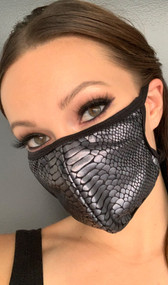Snake print face mask with elastic straps that go around the back of the head to avoid discomfort to your ears. Straps do not tie, you just pull the mask down over your head for a snug fit. Double layered, the inside is cloth lined. Made in the USA.