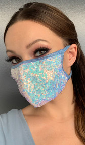 Iridescent sequin face mask with metallic straps. Elastic straps go around the back of the head to avoid discomfort to your ears. Straps do not tie, you just pull the mask down over your head for a snug fit. Double layered, the inside is cloth lined. Made in the USA.