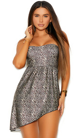 Strapless bandeau style mini dress with asymmetrical hem, gathered waist, and back zipper closure.