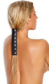Leather hair wrap studded with nail heads and adjustable hook and loop closure.