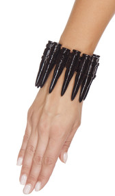 Black bullet wrist cuffs on elastic band with velcro closure. Plastic.