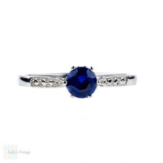 Sapphire Engagement Ring, 0.52 ct Blue Sapphire in Engraved Platinum Setting.