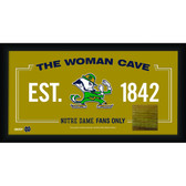 Notre Dame Fighting Irish Logo 10x20 Framed WOMAN CAVE sign with Game used piece of Bench