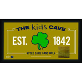 Notre Dame Shamrock Logo 10x20 Framed KIDS CAVE sign with Game used piece of Bench