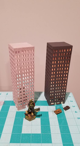 Photo shows two buildings, kit includes one building.