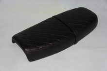 Black cover with diamond pattern