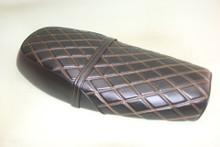 black with orange stitching pattern