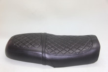 28.5 inches long seat with modified seat pan. The strap is removable.