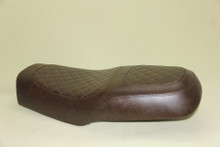 dark brown seat. The strap is removable.