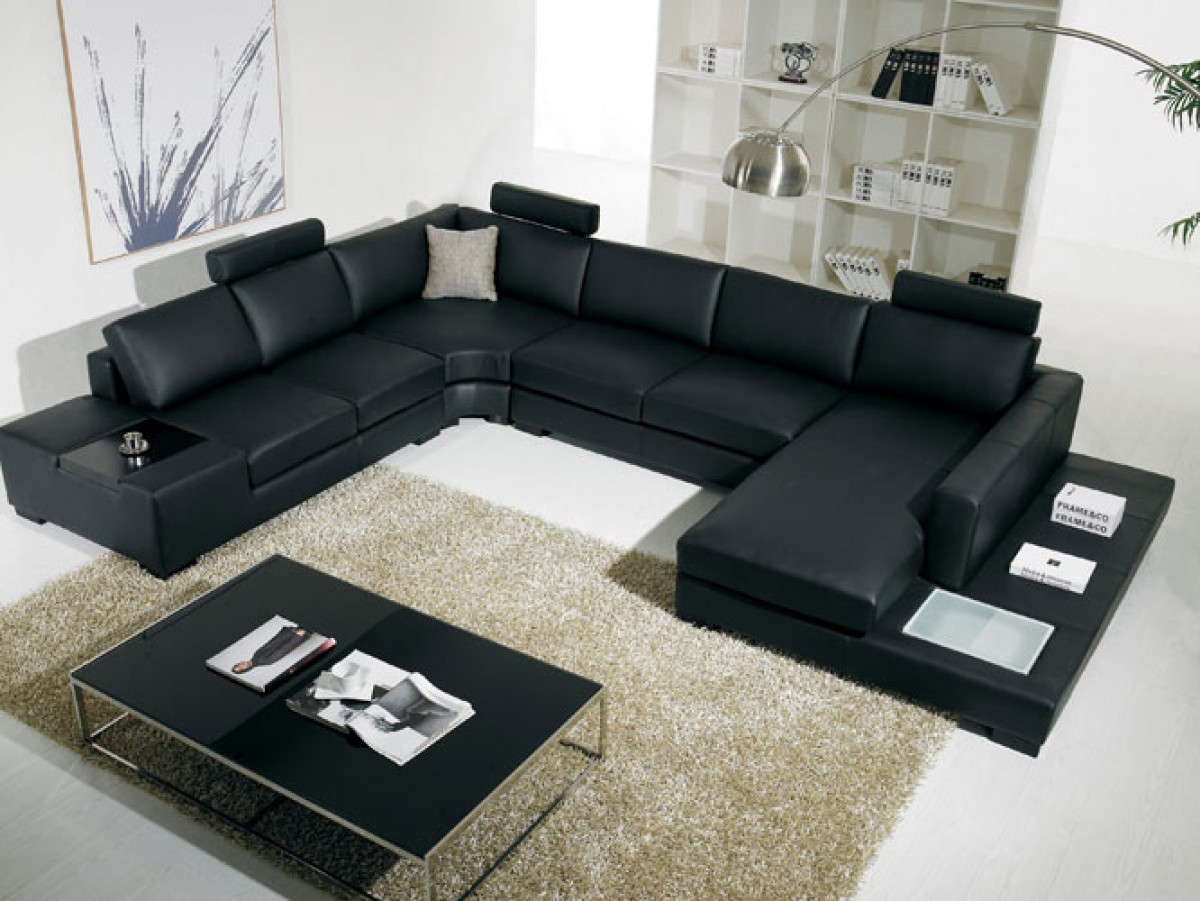 This is a black sectional that is upholstered in bonded leather. This contemporary sectional also features lights.