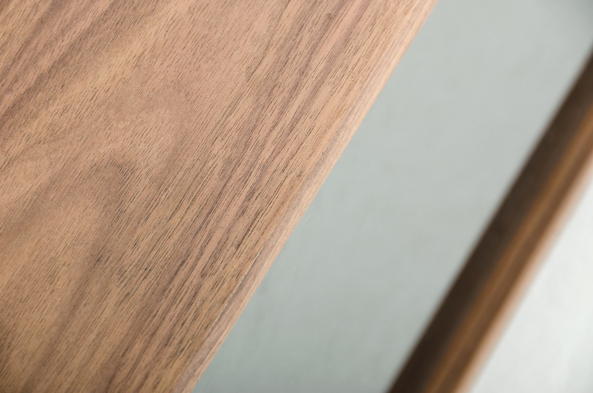 close up of the aiden mid century walnut coffee table