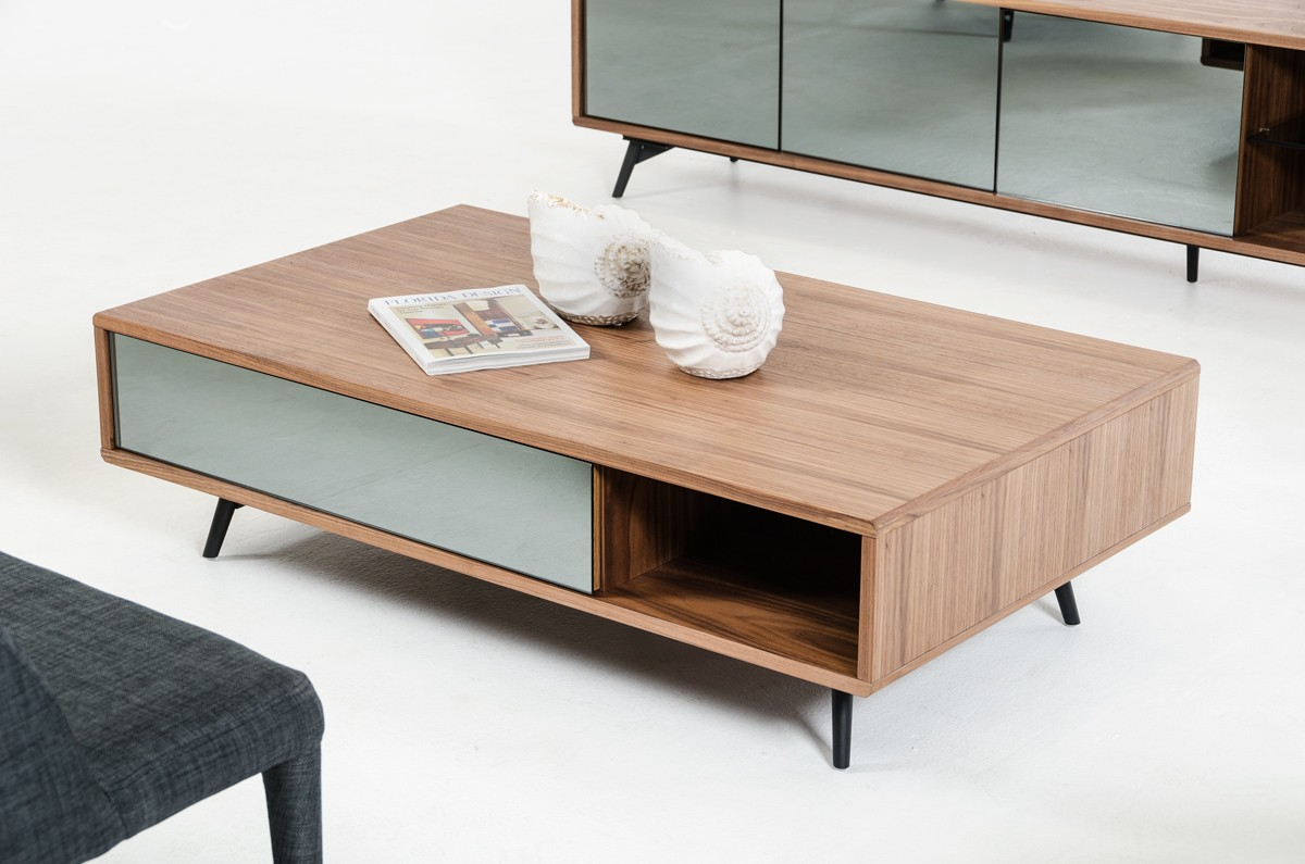 This mid century walnut coffee table is a timeless piece. Available at AdvancedInteriorDesigns.com