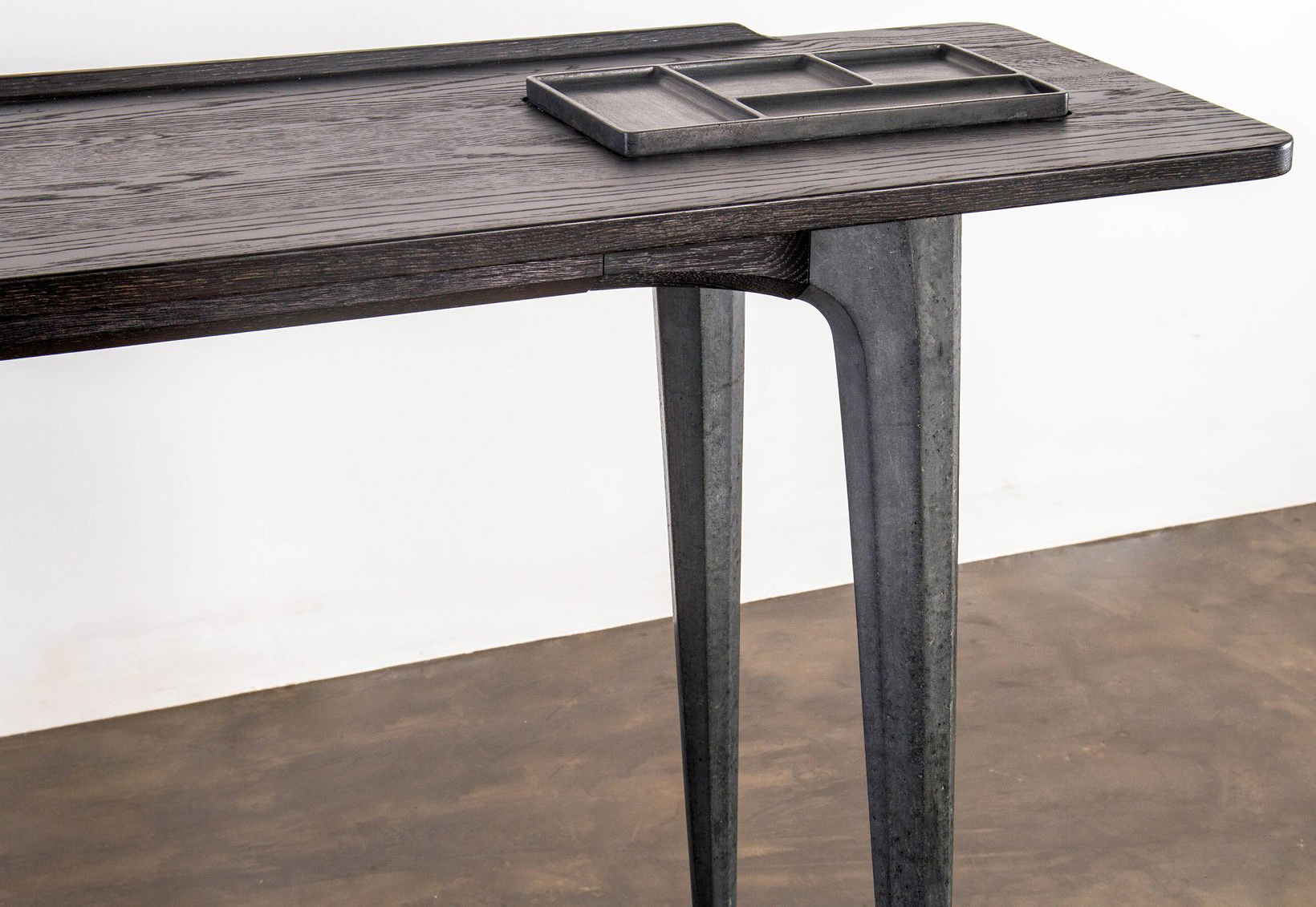 nuevo living salk console table seared oak acid black inserted accessories holder